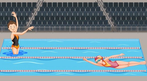 Escena con dos nadadores en la piscina.