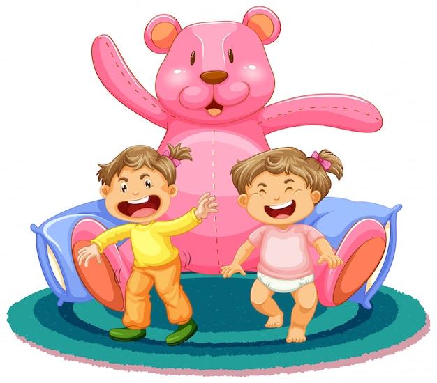 Escena con dos niñas y un oso de peluche gigante