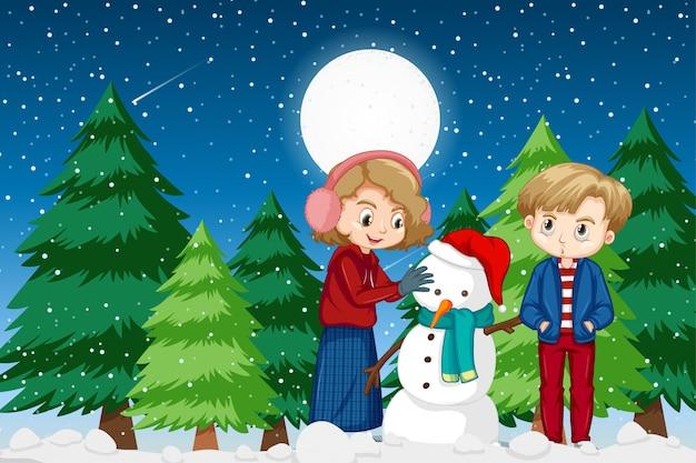 Escena con dos niños y muñeco de nieve en la noche de invierno