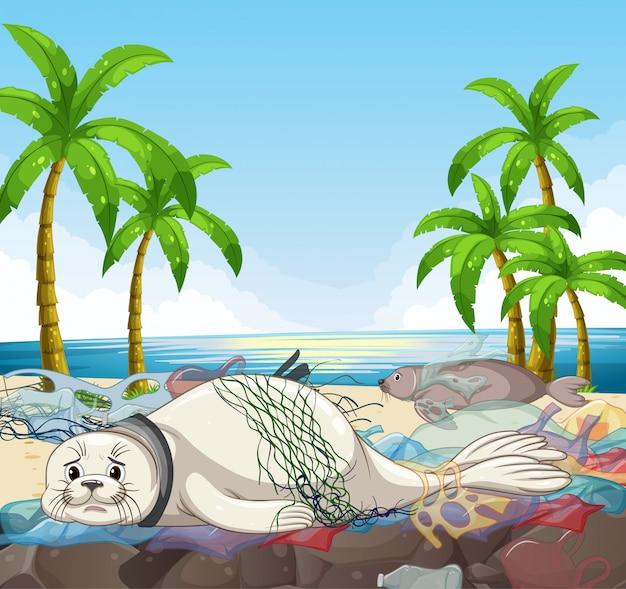 Escena con focas y bolsas de plástico en la playa
