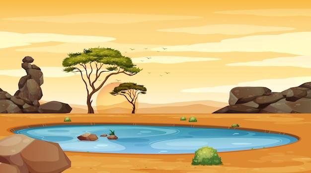 Escena de fondo con estanque y árboles