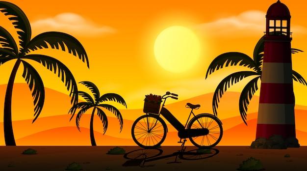 Escena de fondo con puesta de sol y silueta de árboles en la playa