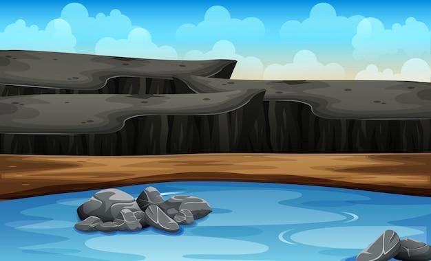 Escena de fondo con valla alrededor de la montaña rocosa