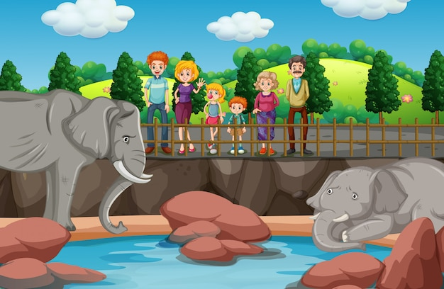 Escena con gente mirando elefantes en el zoológico