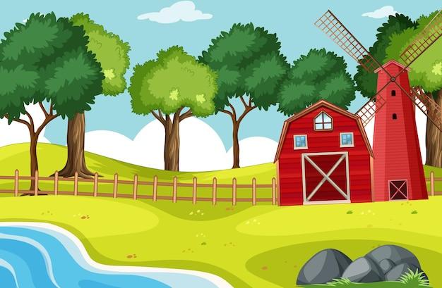 Escena de granero y molino de viento con muchos árboles.