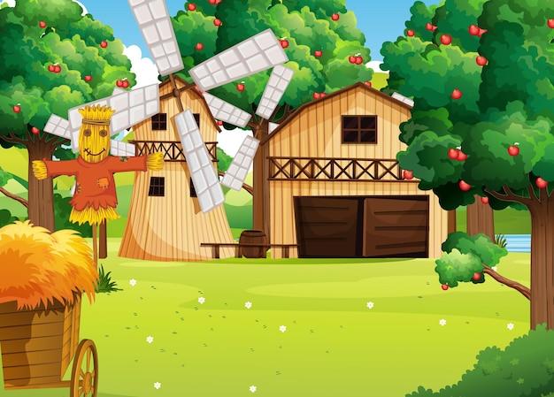 Escena de la granja con casa de campo y molino de viento.