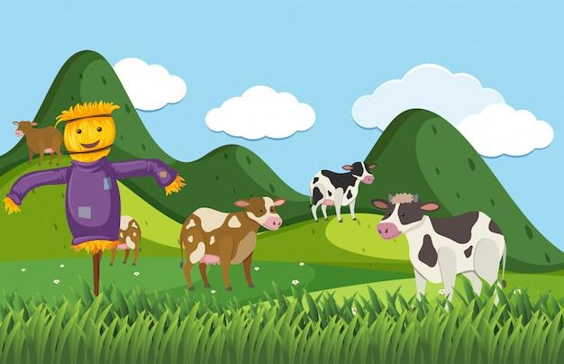 Escena de granja con espantapájaros y muchas vacas en el campo