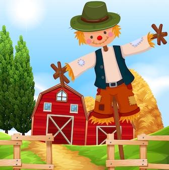Escena de la granja con granero y espantapájaros