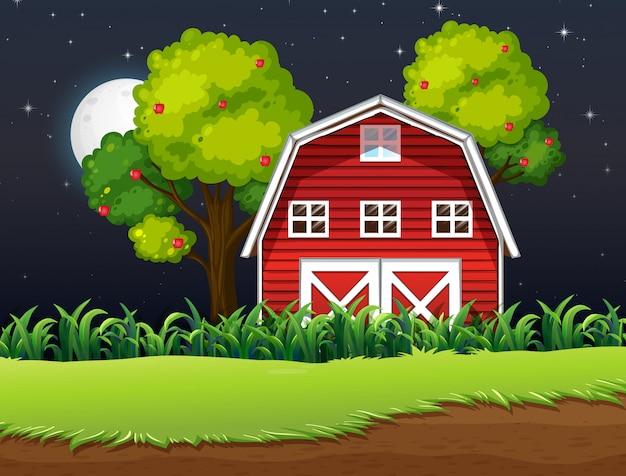 Escena de la granja con granero y manzano en la noche