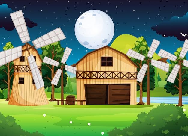 Escena de la granja con granero y molino en la noche