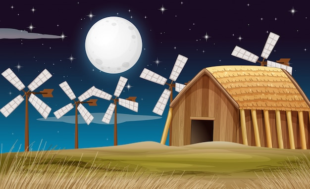 Escena de la granja con granero y molino en la noche.