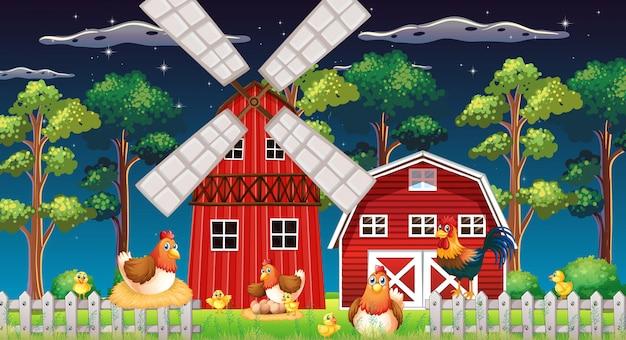 Escena de la granja con granero y molino de viento y pollo en la noche