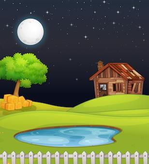 Escena de la granja con granero y pantano en la noche