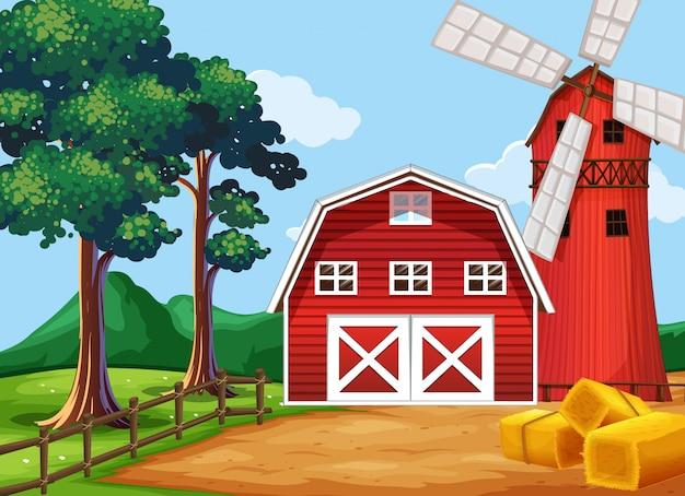 Escena de la granja en la naturaleza con granero y molino de viento