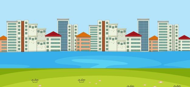 Escena horizontal con fondo de río y paisaje urbano.
