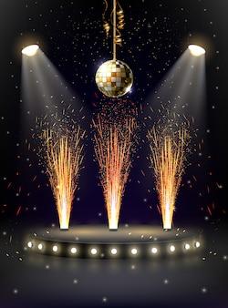 Escena iluminada por focos con fuentes de fuego, fuegos artificiales y bola de discoteca.