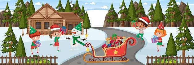 Escena de invierno con muchos niños en tema navideño.