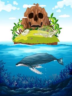 Escena con isla y ballena bajo el agua.
