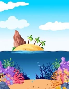 Escena con isla y coral bajo el agua.