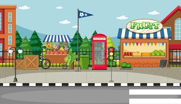 Escena del lado de la calle con carrito de flores y escena de tienda de frutas