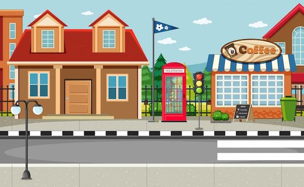 Escena del lado de la calle con casa y cafetería