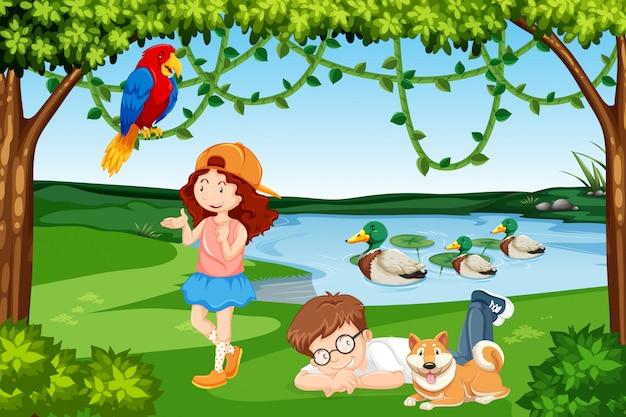 Escena de madera de niños y animales.
