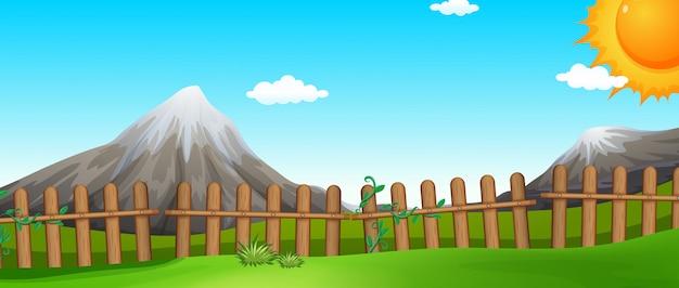 Escena con montañas y campos.