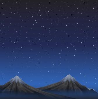 Escena con montañas en el fondo de la noche