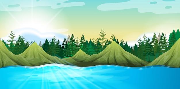 Escena con montañas y pinos.