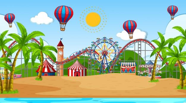 Escena con muchos juegos de circo y globos aerostáticos en la playa.