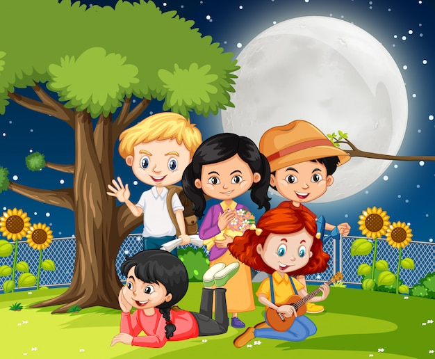 Escena con muchos niños en el parque de noche