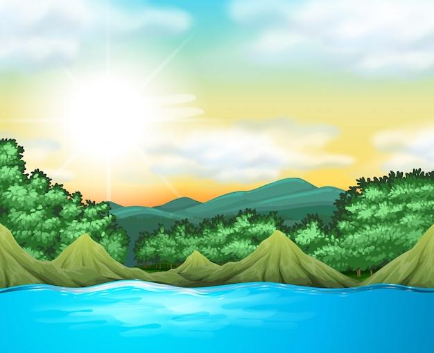 Escena de la naturaleza con arboles y lago.