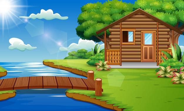 Escena de la naturaleza con casas de madera al borde del río.