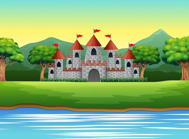 Escena de la naturaleza con castillo y un estanque.