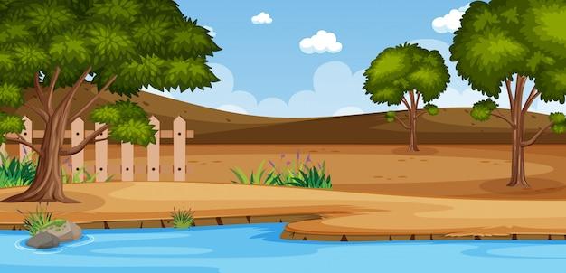 Escena de la naturaleza del horizonte o paisaje del campo con vista a la orilla del bosque y cielo en blanco durante el día