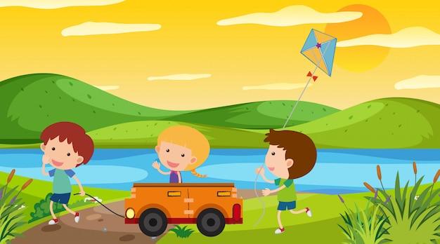 Escena de la naturaleza con niños jugando en el parque