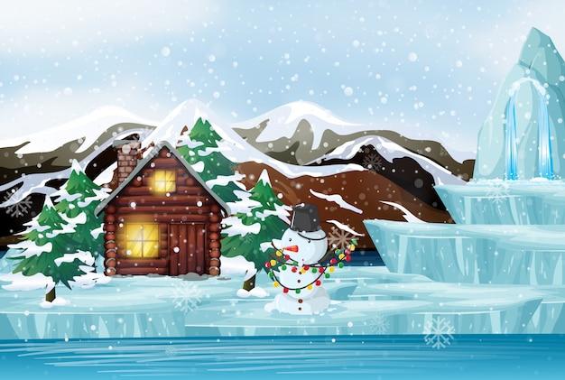 Escena de navidad con muñeco de nieve y cabaña