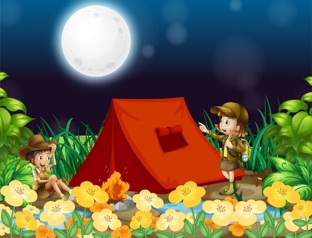 Escena con niños acampando en la noche