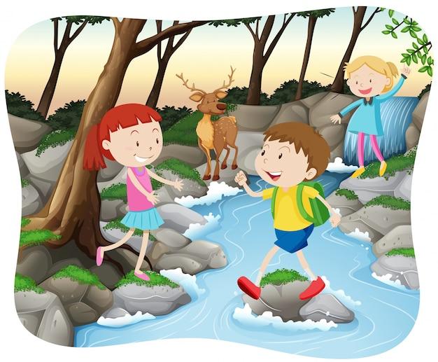 Escena con niños en el bosque