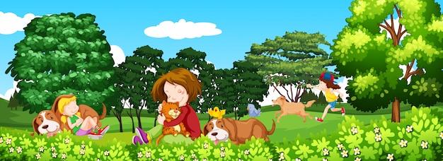 Escena con niños y mascota en el parque.