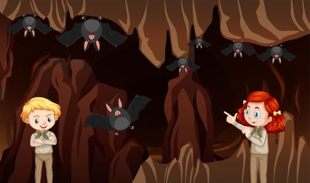 Escena con niños y murciélagos en la cueva
