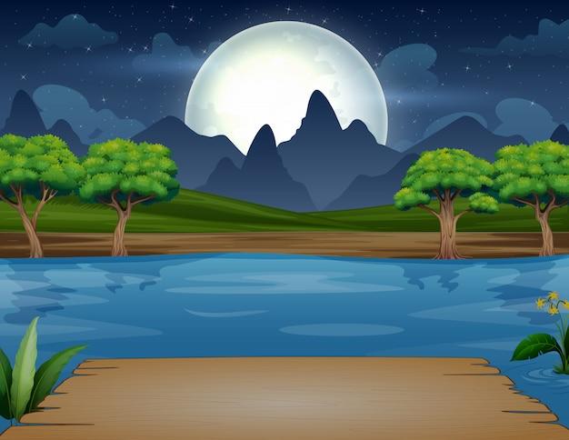 Escena nocturna con banco de madera en el río