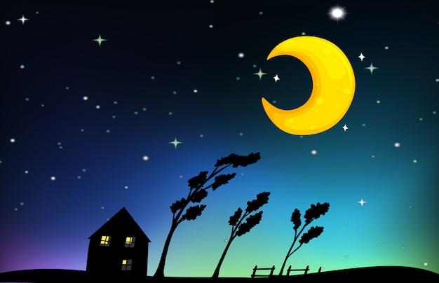 Escena nocturna con casa y arboles.
