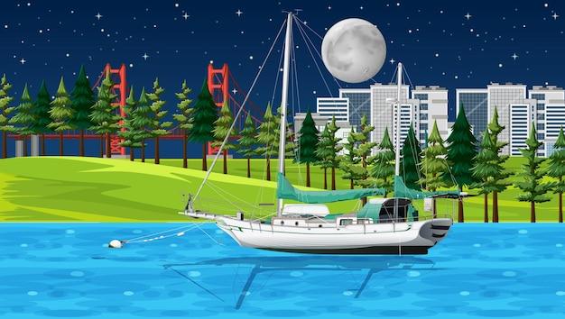 Escena nocturna de río con un barco.