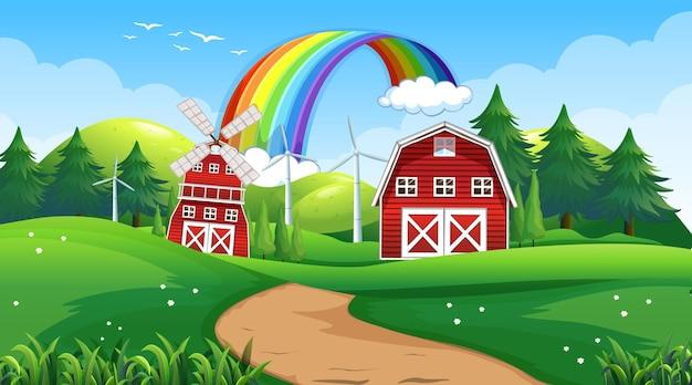 Escena de paisaje de granja con granero y molino de viento.