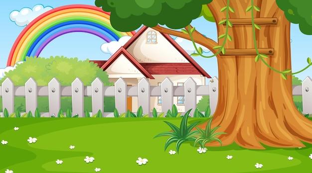 Escena de paisaje natural con una casa y un arco iris en el cielo.