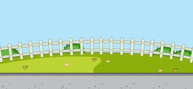 Escena de paisaje de parque vacío con prado y valla blanca