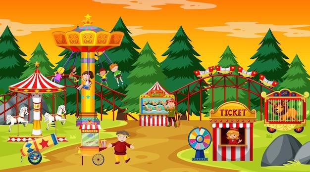 Escena del parque de atracciones durante el día con cielo amarillo.