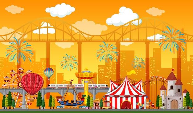 Escena del parque de atracciones durante el día con fuegos artificiales en el cielo.