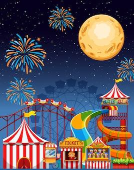 Escena del parque de atracciones en la noche con fuegos artificiales y luna.